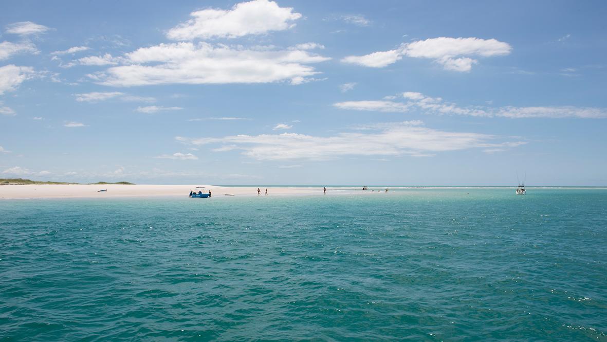 Photographie d'une petite île paradisiaque.