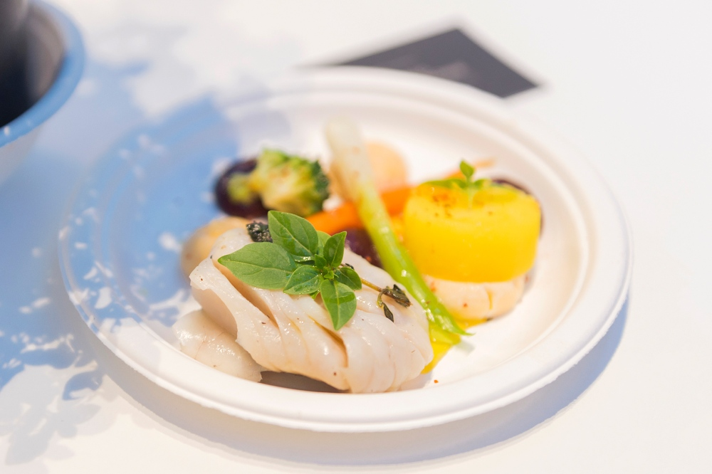 Photographie d'un plat à base de poisson au festival Taste of Paris.