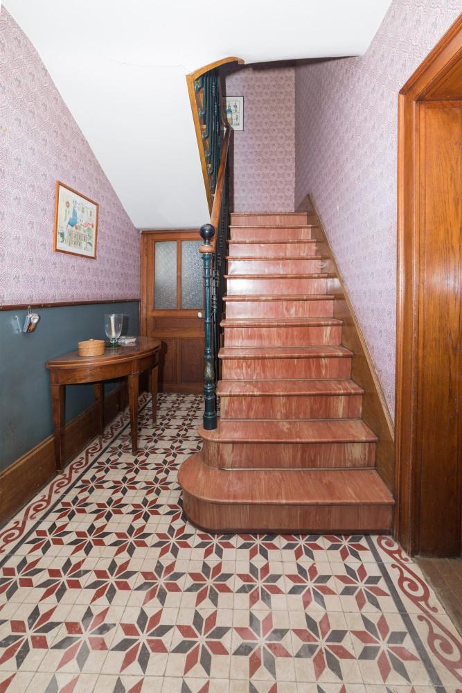 Photographie du rez-de-chaussée d'une habitation pour une agence immobilière.