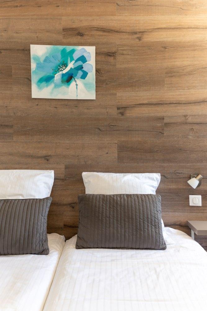 Photographie d'intérieur de chambres d'un hôtel alsacien, zoom sur un élément de décoration.